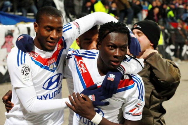 Lyon's French forward Bafetimbi Gomis (R) is congratulated by Lyon's French midfielder Gueida Fofana after scoring a goal during the French L1 football match Lyon (OL) vs Valenciennes (FC) on November 23, 2013 at the Gerland stadium in Lyon.   AFP PHOTO PHILIPPE MERLEPHILIPPE MERLE/AFP/Getty Images