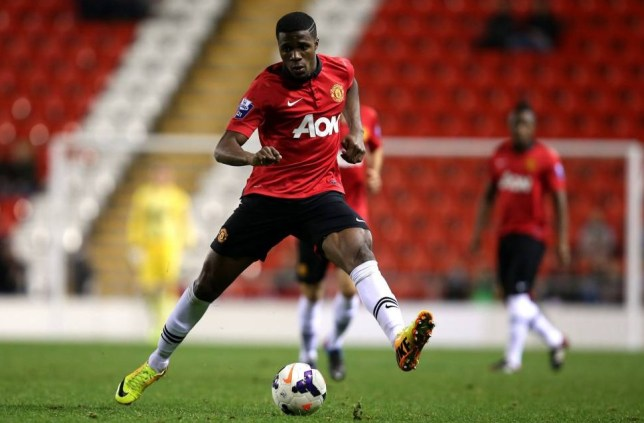 LEIGH, ENGLAND - DECEMBER 02:   Wilfried Zaha of Manchester United U21 controls the ball during the Barclays U21 Premier League match between Blackburn U21 and Manchester United U21 at  Leigh Stadium on December 02, 2013 in Leigh, England.  (Photo by Jan Kruger/Getty Images)