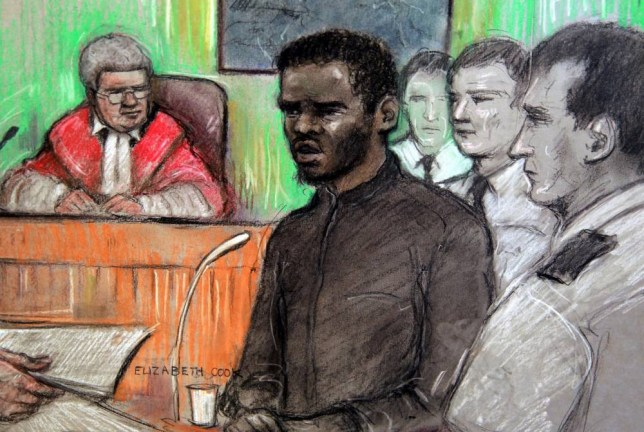"""This is  a Court artist sketch by Elizabeth Cook of Michael Adebolajo, centre, who is one of the men accused of killing British soldier Lee Rigby in May,  as he gave evidence at the  Central Criminal Court """"The Old Bailey"""" in London Monday Dec. 9. 2013. Adebolajo told the court that he loved al-Qaida and considers the groupís members his brothers.  ìI love them. I consider them brothers in Islam,î said  Adebolajo, 28, speaking calmly as he was cross-examined at the court on Monday.  (AP Photo/Elizabeth Cook/PA) UNITED KINGDOM OUT NO SALES  TV OUT INTERNET OUT NO ARCHIVE"""