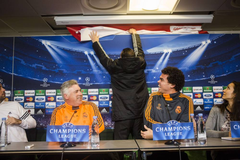 Real Madrid's Champions League press conference hijacked by Greenpeace – video