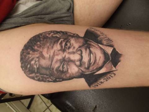 Tattoo artist inks Nelson Mandela likeness for free 'as tribute to a great man'