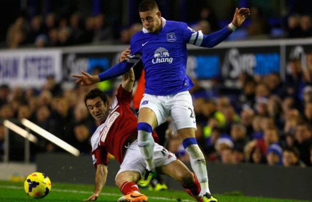 LIVERPOOL, ENGLAND - DECEMBER 14:  Ross Barkley of Everton is challenged by Giorgos Karagounis of Fulham during the Barclays Premier League match between Everton and Fulham at Goodison Park on December 14, 2013 in Liverpool, England. (Photo by Paul Thomas/Getty Images)