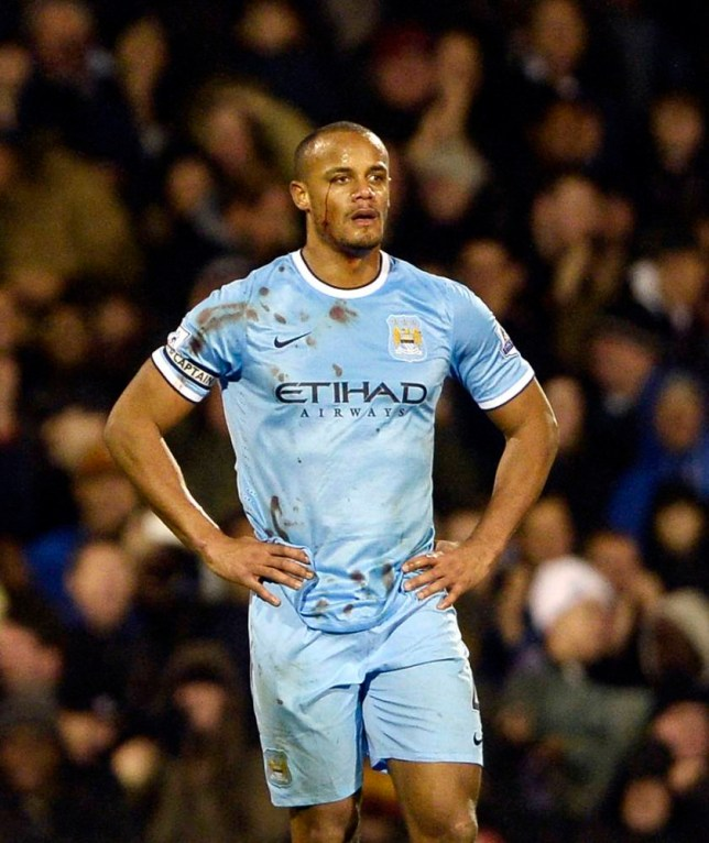 """Manchester City's Vincent Kompany reacts after scoring an own goal for Fulham during their English Premier League soccer match at Craven Cottage in London, December 21, 2013. REUTERS/Dylan Martinez (BRITAIN - Tags: SPORT SOCCER) NO USE WITH UNAUTHORIZED AUDIO, VIDEO, DATA, FIXTURE LISTS, CLUB/LEAGUE LOGOS OR """"LIVE"""" SERVICES. ONLINE IN-MATCH USE LIMITED TO 45 IMAGES, NO VIDEO EMULATION. NO USE IN BETTING, GAMES OR SINGLE CLUB/LEAGUE/PLAYER PUBLICATIONS. FOR EDITORIAL USE ONLY. NOT FOR SALE FOR MARKETING OR ADVERTISING CAMPAIGNS"""