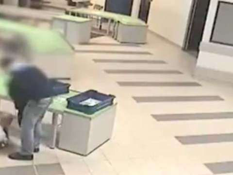 Airport security guard's dive to catch child falling from luggage counter – video