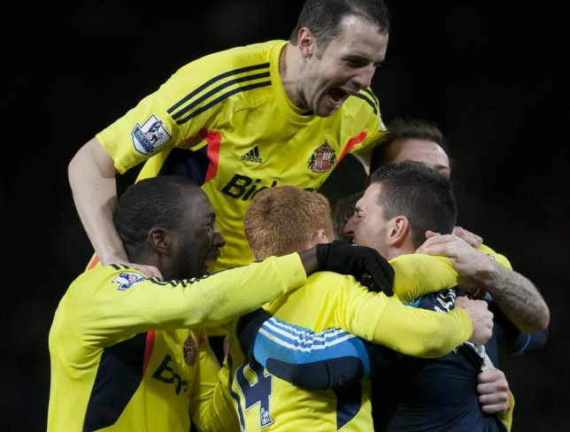 Sunderland players embrace goalkeeper Vito Mannone after his penalty saves last night (Picture: AP)