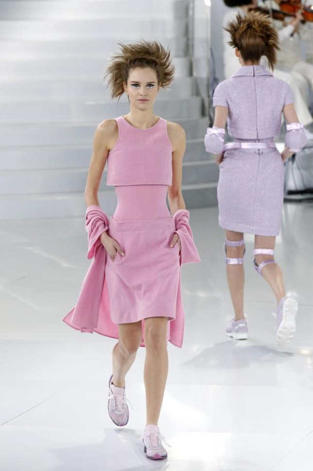 Karl Lagerfeld sent models down the catwalk in couture and trainers for his SS14 Chanel Couture show in Paris (Picture: REUTERS/Benoit Tessier Benoit Tessier/Reuters)