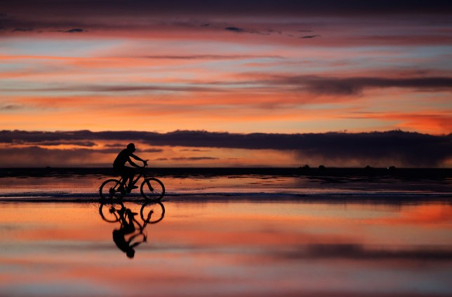 Riding into the sunset. (Photo by Dean Mouhtaropoulos/Getty Images)