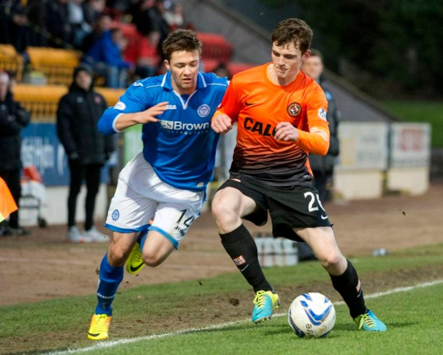 29/12/13 SCOTTISH PREMIERSHIP ST JOHNSTONE V DUNDEE UTD MCDIARMID PARK - PERTH Dundee Utd's Andrew Robertson (right) blocks the run from Gwion Edwards.