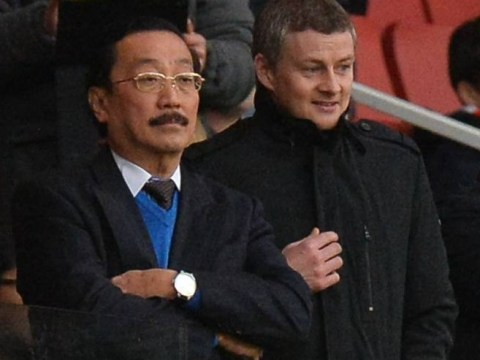 Soon-to-be Cardiff boss Ole Gunnar Solskjaer pictured with BLUE jumper-wearing Vincent Tan at Arsenal