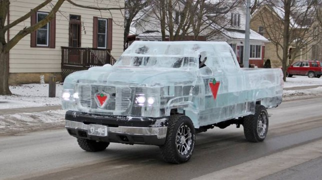 PIC BY ICECULTURE / CATERS NEWS - (PICTURED: TRUCK MADE FROM ICE) - A working truck carved out of more than 11,000lb of ice is gearing up for a place in the record books. The truck was sculpted by a team from Ontario, Canada, and comes complete with license plates and pine tree-shaped air freshener around the frame of a regular chassis. Artists at Iceculture also added a steel frame to provide extra support as well as fans which prevented hot air and exhaust fumes from melting the exterior. They drove it for about a mile at a speed of 12mph - and now hope the project will be named a Guinness World Record. SEE CATERS COPY