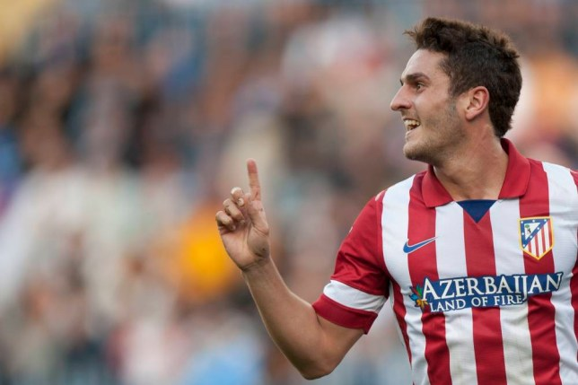 "Atletico de Madrid's Jorge Resurreccion ""Koke"" celebrates his goal during a Spanish La Liga soccer match between Malaga and Atletico de Madrid at the La Rosaleda stadium in Malaga, Spain, Saturday, Jan. 4, 2014. (AP Photo/Daniel Tejedor)"