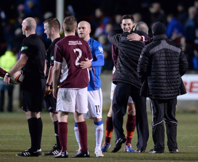 05/01/14 SCOTTISH LEAGUE ONE STENHOUSEMUIR v RANGERS OCHILVIEW - STENHOUSEMUIR Stenhousemuir's John Gemmell with Rangers manager Ally McCoist after the final whistle.