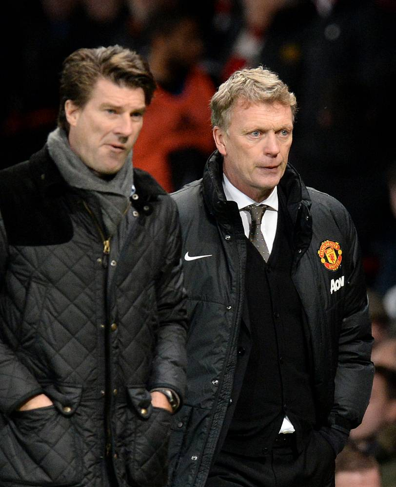 Manchester United manager David Moyes shows is dejection as he leaves the pitch after their 2-1 defeat against Swansea City with Michael Laudrup (left) during the FA Cup Third Round match at Old Trafford, Manchester. PRESS ASSOCIATION Photo. Picture date: Sunday January 5, 2014. See PA story SOCCER Man Utd. Photo credit should read: Martin Rickett/PA Wire. RESTRICTIONS: Editorial use only. Maximum 45 images during a match. No video emulation or promotion as 'live'. No use in games, competitions, merchandise, betting or single club/player services. No use with unofficial audio, video, data, fixtures or club/league logos.