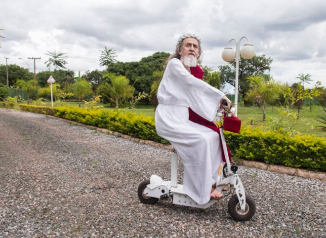 Inri Cristo rides his mobility scooter through the Brazilian farmland he owns. The 66-year-old has been preaching since 1979 and believes he is the reincarnation of Jesus Christ (Picture: Barcroft)