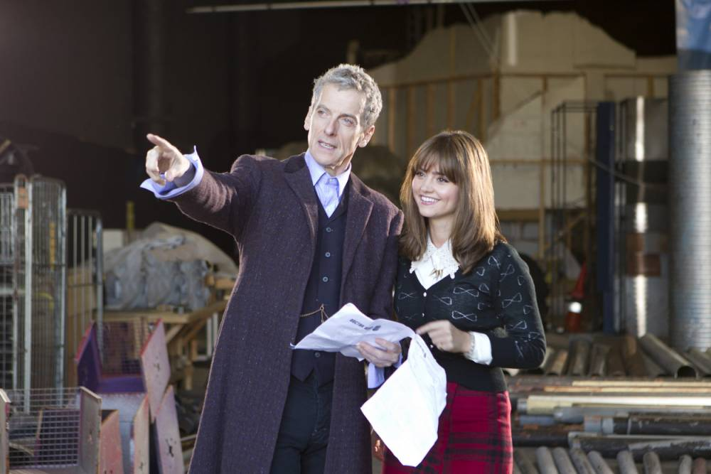 For use in UK, Ireland or Benelux countries only. BBC handout photo of the new Doctor Who, Peter Capaldi with Jenna Coleman, who plays Clara Oswald, on set for his first full day of filming as production begins on series 8 of the hit BBC show. PRESS ASSOCIATION Photo. Issue date date: Tuesday January 7, 2014. See PA story SHOWBIZ Who. Photo credit should read: BBC/PA Wire NOTE TO EDITORS: Not for use more than 21 days after issue. You may use this picture without charge only for the purpose of publicising or reporting on current BBC programming, personnel or other BBC output or activity within 21 days of issue. Any use after that time MUST be cleared through BBC Picture Publicity. Please credit the image to the BBC and any named photographer or independent programme maker, as described in the caption.