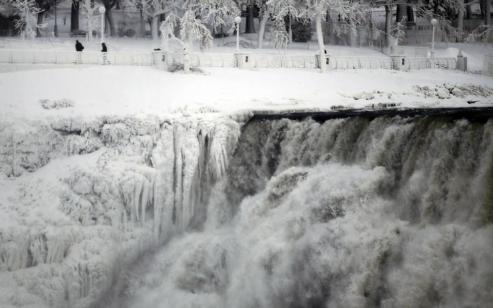 Niagara Falls frozen in time by The Polar Vortex (Picture: Reuters/Aaron Harris)