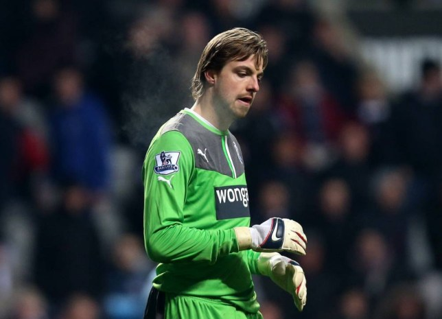 Newcastle United's goalkeeper Tim Krul stands dejected after being defeated by Manchester City at the end of their English Premier League soccer match at St James' Park, Newcastle, England, Sunday, Jan. 12, 2014. (AP Photo/Scott Heppell)