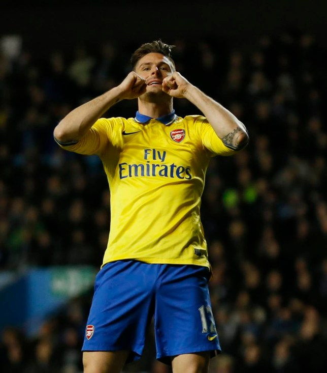 Arsenal's Oliver Giroud reacts in frustration after missing a chance to score a goal during the English Premier League soccer match between Aston Villa and Arsenal at Villa Park stadium in Birmingham, England, Monday, Jan. 13, 2014. (AP Photo/Kirsty Wigglesworth)