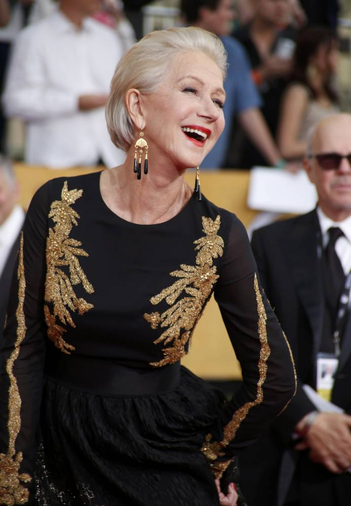 Actress Helen Mirren arrives at the 20th annual Screen Actors Guild Awards in Los Angeles, California January 18, 2014.  REUTERS/Lucy Nicholson  (UNITED STATES Tags: ENTERTAINMENT)(SAGAWARDS-ARRIVALS)