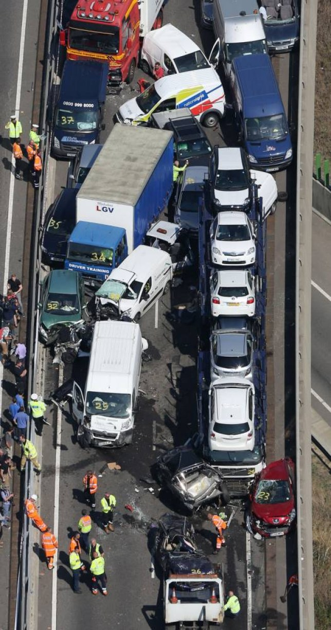 File photo dated 05/09/2013 of a general view of the scene on the London bound carriageway of the Sheppey Crossing, near Sheerness in Kent following a pile-up, as police who found enough evidence to prosecute 32 motorists following the 150-car pile-up have offered to send them on a driver alertness course instead. PRESS ASSOCIATION Photo. Issue date: Monday January 20, 2014. A senior police officer said handing the drivers a chance to go on the course would be more beneficial than putting them before the courts. See PA story POLICE Accident. Photo credit should read: Gareth Fuller/PA Wire