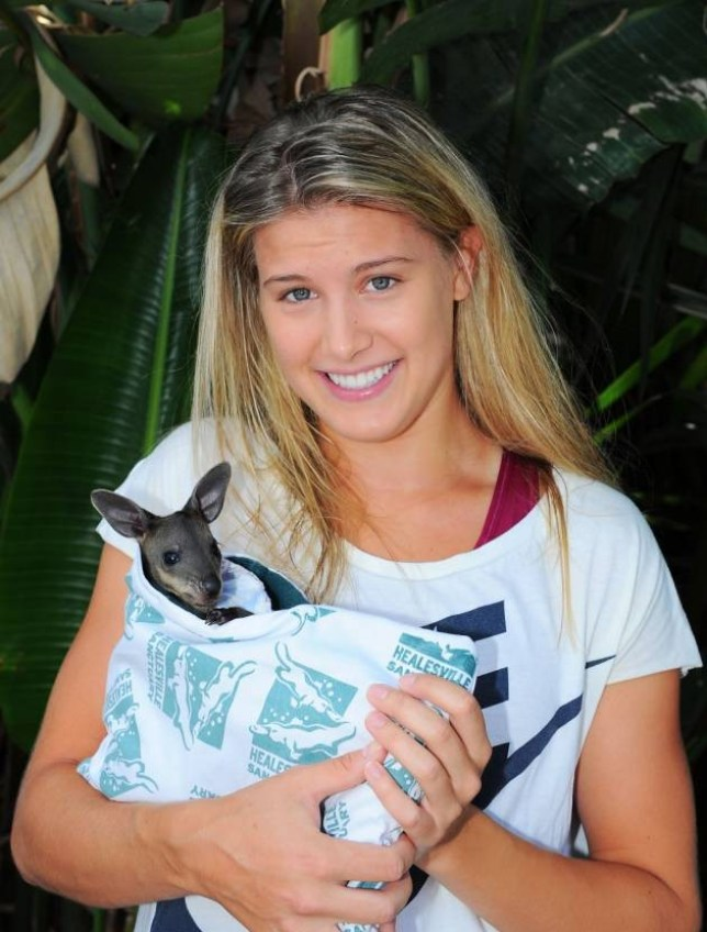 MELBOURNE, AUSTRALIA - JANUARY 22: Eugenie Bouchard of Canada holding a baby Wallaby at the player Cafe during day 10 of the 2014 Australian Open at Melbourne Park on January 22, 2014 in Melbourne, Australia. (Photo by Vince Caligiuri/Getty Images)