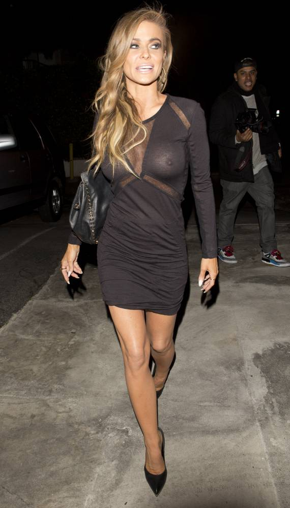 Carmen Electra suffers unexpected wardrobe malfunction as little black dress turns see-through