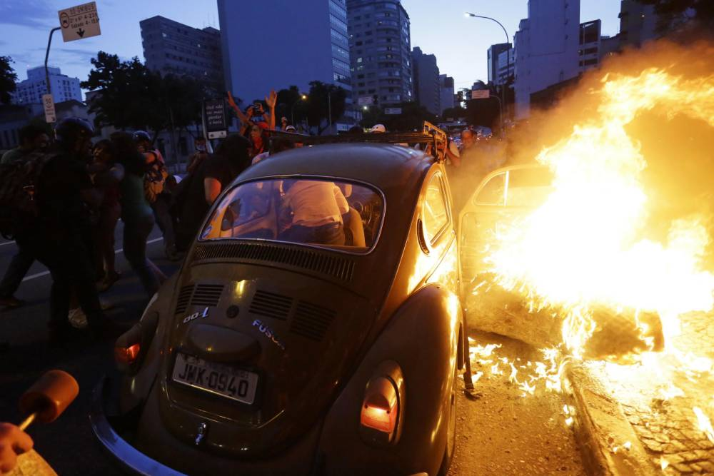 Protests against World Cup in Brazil turn violent as thousands take to the streets