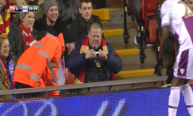 This Liverpool fans knows a good photo opportunity when he sees it (Picture: Sky Sports)