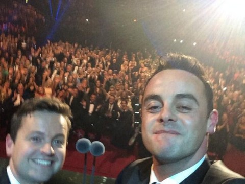 Now that's what you call a selfie! Emotional Ant and Dec capture spontaneous snapshot as they win lifetime achievement gong at National Television Awards 2014