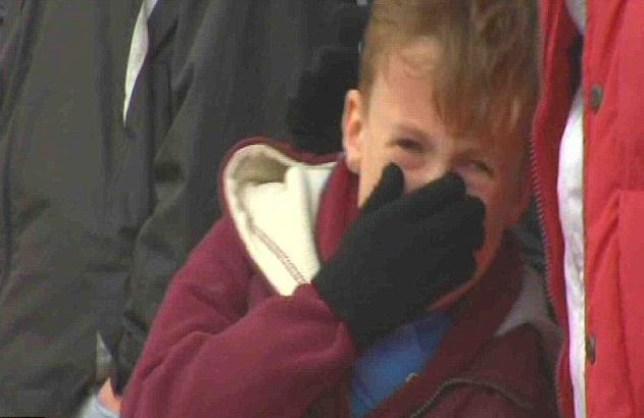 Boy cries at West Ham exit