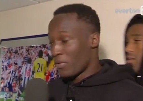 Romelu Lukaku shows off shaved head as Sylvain Distin pinches his hat during TV interview – video