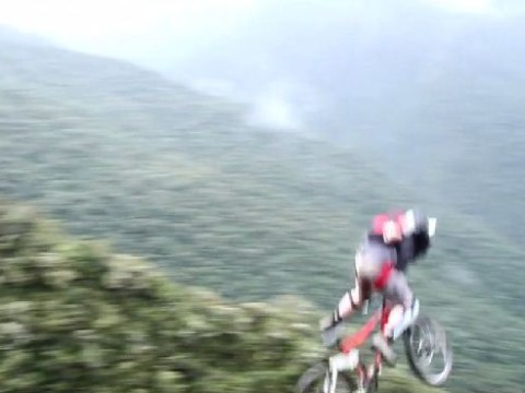 Video: Base jumper cycles off 'Death Road' in Bolivia and lands in a forest – but somehow survives