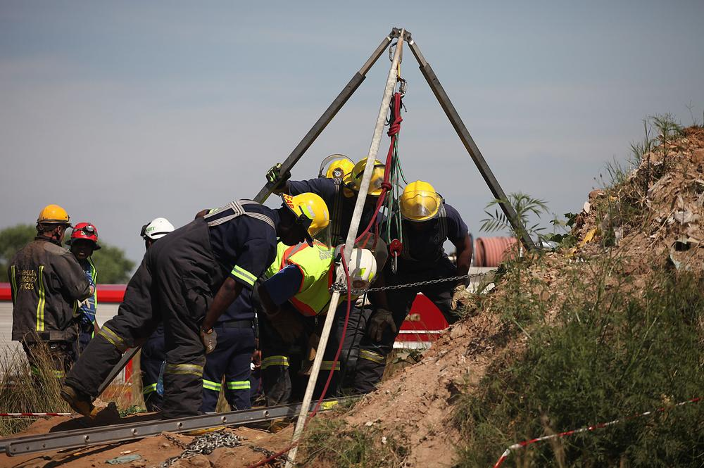 Illegal miners rescued from Johannesburg gold mine 'refusing to come up'