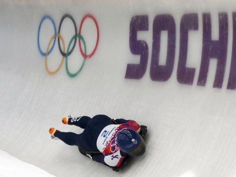 Sochi 2014 Winter Olympics: Britain's Lizzy Yarnold leads skeleton after second heat to stay on course for gold medal