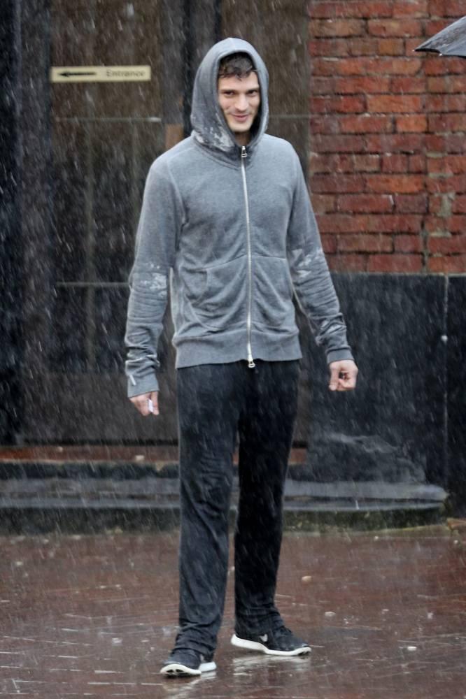 Fifty Shades of Grey star Jamie Dornan gets soaked shooting erotic film