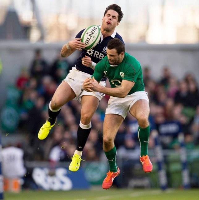 02/02/14 RBS SIX NATIONS IRELAND v SCOTLAND AVIVA STADIUM - DUBLIN Scotland's Sean Maitland (left) rises in the air with David Kearney