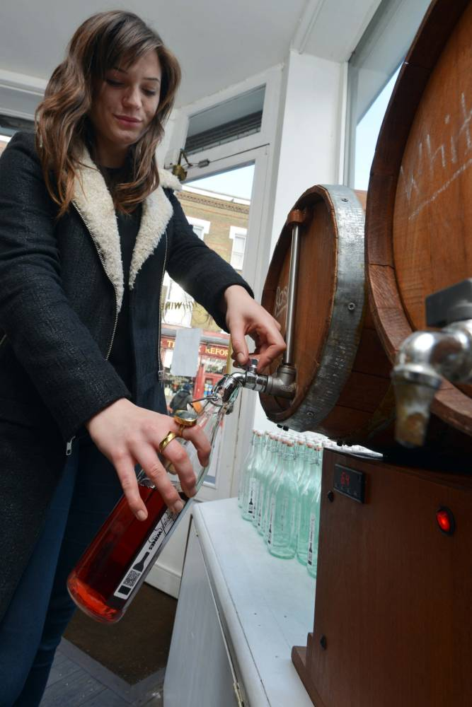Amy fills up on one of her favourite 'essentials' at Borough Wines in east London (Picture: Daniel Lynch)