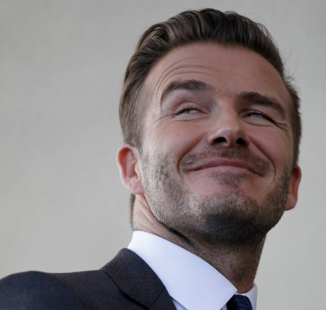 David Beckham smiles as he discusses matters related to the ownership position he has with a proposed Major League Soccer (MLS) expansion team, at a news conference in Miami, Florida February, 5, 2014. Former England soccer captain Beckham announced on Wednesday that he is exercising his option to become the owner of a Major League Soccer team in Miami.     REUTERS/Andrew Innerarity (UNITED STATES - Tags: SPORT SOCCER ENTERTAINMENT BUSINESS)