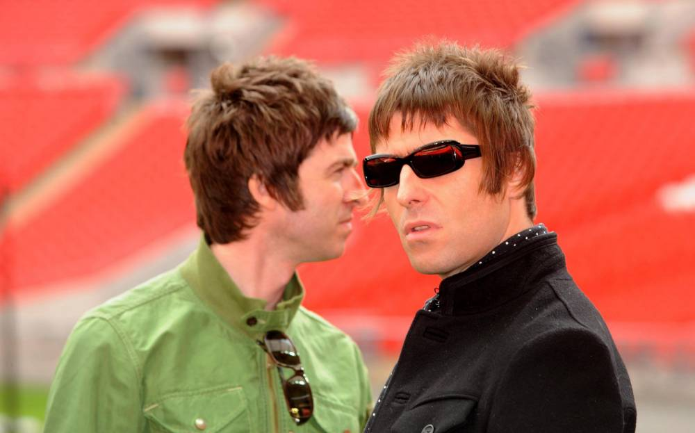 File photo dated 16/10/08 of Noel Gallagher and Liam Gallagher as Pharrell Williams has revealed that reuniting the feuding Gallaghers for a collaboration would make him Happy. PRESS ASSOCIATION Photo. Issue date: Thursday February 6, 2014. The singer and producer - who was guest vocalist on Daft Punk's Get Lucky - said teaming up with former Oasis stars Noel and Liam would be one of his dream projects. The pair have not spoken since Noel stormed out of the group in 2009 following years of friction and he has his own solo career while Liam continued to work with his Oasis bandmates under the name Beady Eye. See PA story SHOWBIZ Pharrell. Photo credit should read: Zak Hussein/PA Wire