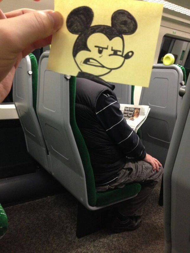 October Jones: Animator draws cartoon heads on train passengers on commute