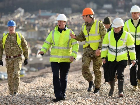 Stop bickering and get on with the job: Cameron attempts to end flood crisis squabbling