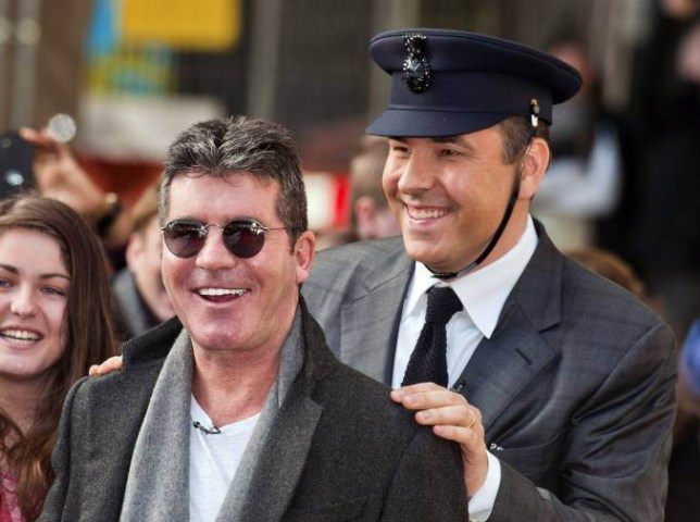 Britain's Got Talent judges Simon Cowell (left) and David Walliams arrive for auditions at the Hammersmith Apollo in west London. PRESS ASSOCIATION Photo. Picture date: Tuesday February 11, 2014. See PA story SHOWBIZ Talent. Photo credit should read: Will Oliver/PA Wire