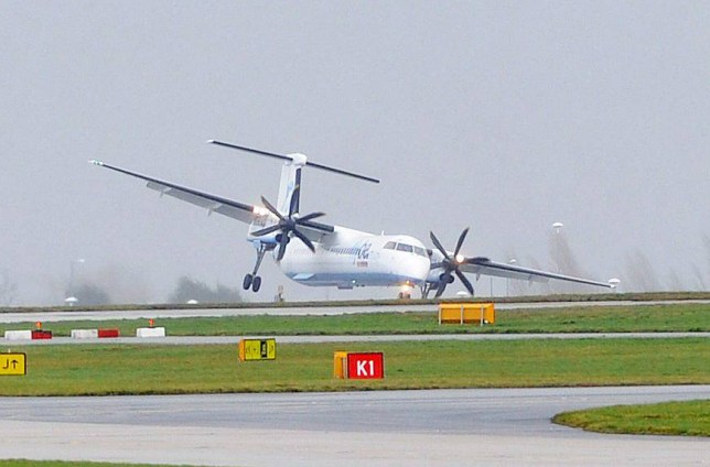 Plane's wings almost clip runway during gale force winds