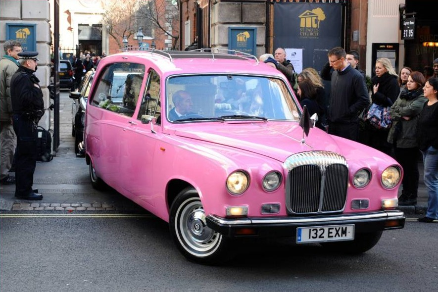 Bright send-off: The distinctive hearse at St Paul's Church in London