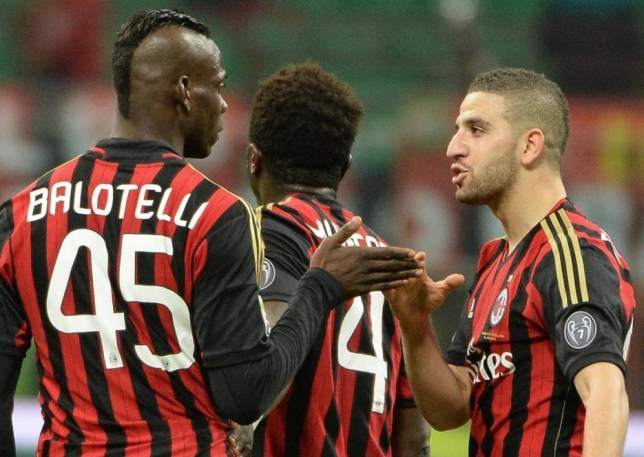 epa04078268 Italian forward of AC Milan, Mario Balotelli (L), jubilates with his teammate Adel Taarabt (R) after scoring a goal during the Italian Serie A soccer match between AC Milan and Bologna FC at Giuseppe Meazza stadium in Milan, Italy, 14 February 2014.  EPA/DANIEL DAL ZENNARO
