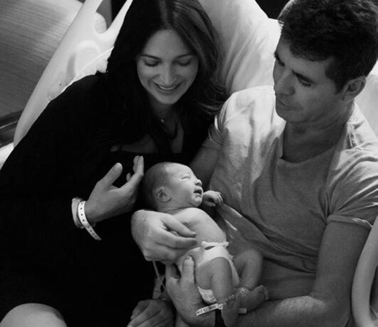 Mum, Dad and Eric: Simon revealed his son to the world  (Picture: Twitter/Simon Cowell)