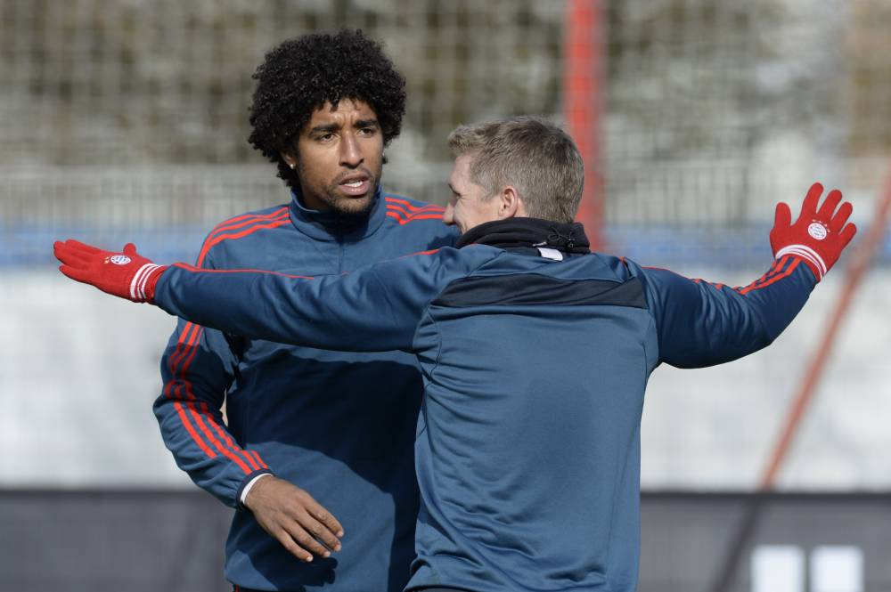 Bayern Munich's Brazilian defender Dante (L) and teammate midfielder Bastian Schweinsteiger (R) warm up during the final training session at the trainings area in Munich, southern Germany, on February 18, 2013, a day ahead of the UEFA Champions League round of sixteen first leg football match FC Arsenal vs FC Bayern MunichAFP PHOTO / CHRISTOF STACHECHRISTOF STACHE/AFP/Getty Images