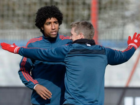 Touchy! Bayern Munich's Dante restrained by team-mates as press laugh at training-ground error