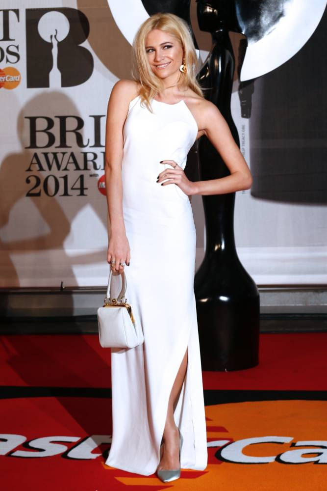 British singer-songwriter Pixie Lott poses on the red carpet arriving at the BRIT Awards 2014 in London on February 19, 2014. AFP PHOTO / ANDREW COWIEANDREW COWIE/AFP/Getty Images