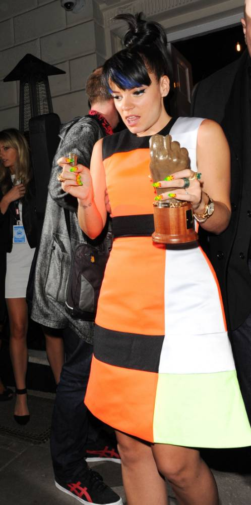 Good night was it? Lily Allen breaks the middle finger off her NME award before she even gets it home